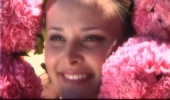 bride face surrounded by pink flowers at BeckenRidge Vineyard in Oregon, from wedding video sample clip by Focal Point Digital Media